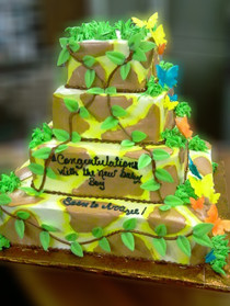 Approximate Servings 145. Sizes: 1/8 sheet sq, 1/4 sheet sq, 1/2 sheet sq & 3/4 sheet sq. This jungle themed baby shower cake has cascading sugar butterflies to lighten it up a bit with some color and detail.