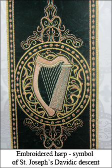embroidered harp symbol