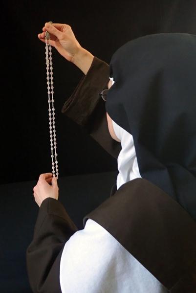 sister making a rosary