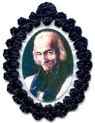 Crocheted relic badges of St. John Vianney, badge of St. John Vianney with relic, cloth touched to the relic of the saint