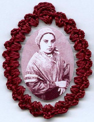 Crocheted relic badges of St. Bernadette of Lourdes, badge of St. Bernadette Soubirous with relic, cloth touched to the relic of the saint