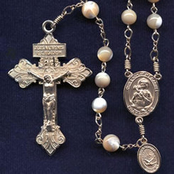 Rosary from a gallery of rosaries handmade by nuns: Natural Mother of Pearl beads with Gold filled Pardon crucifix and parts, Our Lady of Mt. Carmel center and Holy Spirit side medal