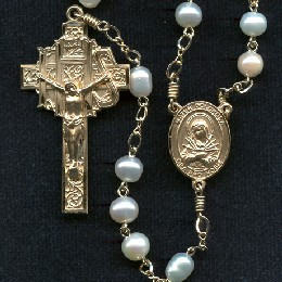 Rosary from a gallery of rosaries handmade by nuns: Round Freshwater Pearl beads with Gold Filled parts and Oval Our Father beads