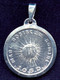 Reverse side of sterling silver medal