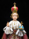 Infant of Prague Statue on Base With Prayer (Close-up)