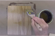 Brush in the direction of the grain and apply thin coats of finish
