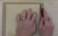 Trim the excess veneer with a razor knife