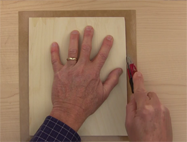 Trim off the excess veneer using a razor knife