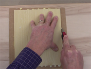 Trim the veneer with a razor knife to get an exact fit
