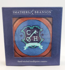 Blue Pig and Crest Needlepoint Coasters