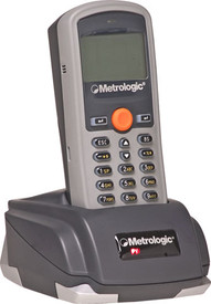 Honeywell (Metrologic) SP5500 OptimusS Batch Barcode Scanner.  Shown with charging and communications base. This base comes with the unit.