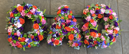 The letters of 'Dad' prepared here in a vivid mix of bright flowers. We can prepare in any colours and in any style. We charge £50 per letter. Do contact our team who can help in the event of any query or if you require help or advice.