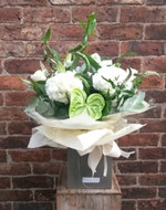 A handtied aquapac bouquet made up of a selection of white and green flowers.