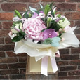 Stunning Vanda orchid heads sit within fluffy pink hydrangea and cream flowers for this beautiful handtied aquapac bouquet.