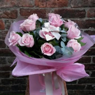 A handtied aquapac bouquet featuring 12 of the finest pink Avalanche roses, arranged with salal leaves and eucalyptus. Beautifully presented and packaged, including a lovely little East of India heart tag.