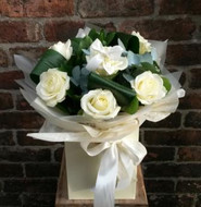 A handtied aquapac bouquet featuring 6 of the finest white Avalanche roses, arranged with salal leaves and folded aspidistra. Beautifully presented and packaged, including a lovely little East of India heart tag.