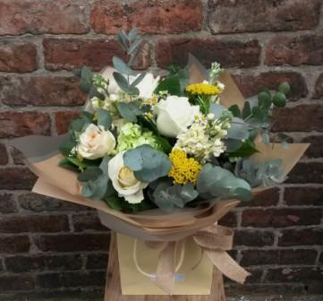 A lovely fresh handtied bouquet of lemon, cream and green shades. Featuring roses, stocks, tanacetum, hydrangea, achillea and eucalyptus. Beautifully arranged, packaged and presented.