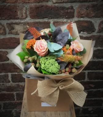 A lovely rustic handtied bouquet of zesty oranges and limes. Featuring roses, Bramen berries, celosia, kniphovia and fragrant eucalyptus. Beautifully arranged, packaged and presented.