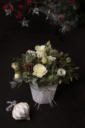 Our White or Red Christmas pots are compact and convenient and a super little 'just thinking about you' festive gift. Prepared in floral foam, we use White or Red Roses as the focal flowers, and then use complementary festive flowers and accessories that will look equally at home on a hall table, a mantle, on a window-sill or in the kitchen.