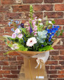 A new design for Spring 2019, this is how we imagine an English Country Garden as a bouquet! This lovely arrangement includes Delphiniums, delicate spray roses, Anemone, Veronica, pink Gerbera and romantic Greenbell. Sure to appeal to both lovers of a nostalgic country style and 'wild and rustic' flower arrangements.
