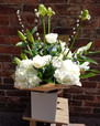 Pure White and Green Luxury! This beautiful bouquet has the real 'wow' factor. Lovers of clean, neutral floral arrangements will be over the moon to receive this one! (Flower content can vary due to availability).