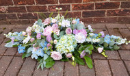 This beautiful tribute includes soft blues, lilacs and pinks. (This particular 3' tribute was designed to echo the blue colour schemes from Monet's Garden). We can arrange flowers to any colourway, please do not hesitate to contact our friendly team to discuss your specific requirements.