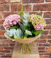 Our 'Hydrangea Beauty' Bouquet is a gorgeous selection of 3 Hydrangea flowers, with dried lavender to provide added interest and fragrance, and selected foliage. A very popular selection within our shop, these flowers look simply stunning when placed in a vase. Gift wrapped in an Eco style of only traditional brown paper, this is sure to have a broad range of appeal.