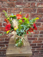 Our Autumn Sunshine vase is sure to bring a smile to the face of the recipient. Self contained as it is supplied in it's own vase, we include a selection of autumnal flowers and leaves and natural accents such as apples, berries, interesting twigs, acorns or beech shells - anything that we can gather on the day that will say 'Autumn'.
