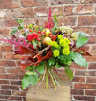 Our very special bouquet for the Autumn! Our award-winning Florist Kat has designed this wonderful bouquet to remind you of a sunny  walk on a crisp Autumn day. Flowers in deep Reds and Oranges, berries and coloured leaves with interesting and surprising natural accents. A sure-fire talking point! Each one will be slightly different, which we think adds to it's appeal!