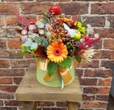 Our lovely hatbox re-imagined for Autumn. Including autumnal flowers in russets, oranges and golds with foliages, with natural accents. Each box will be slightly different, which adds to their charm!
