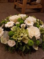 A classic, traditional design of Funeral Tribute. This example includes a collection of white and cream flowers with variegated greenery which combine to create a simple and beautiful tribute. Image shown is Large (£65). If you prefer a different colour combination please speak to our friendly team on 01625 522228 they will be pleased to assist you.