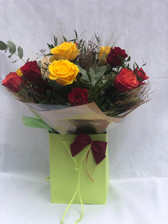 Our 'Autumn Kisses' bouquet is a gorgeous selection of 12 roses in the eponymous Autumn pallet of Oranges, Reds and Golden Yellows.  A luxurious treat, a Rose Bouquet is something particularly special to receive and the mix of colours in our 'Kisses' bouquet adds something just a little different...