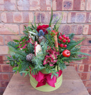 Hatboxes are a firm favourite with Chelsea Flowers' customers and this Festive version is a real treat. In the traditional colours of the season, it contains seasonal foliage and natural accents which mean it's beautiful when viewed at every angle. Perfect as a table or sideboard decoration and a wonderful gift.