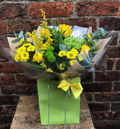 Our 'Sunshine and Smiles' bouquet, packs a bright punch of zesty yellow floral fabulousness, including yellow roses signifying friendship. The contrasting vivid green flowers and complementary foliage make this bouquet an ideal pick me up gift (even for yourself!).