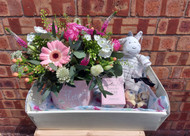 Our 'Welcome Baby' Gift box is a truly sweet selection including a Seasonal Hatbox (Summer Hatbox shown on our image) a cute plush toy, (Zebra on image), a Gisela Graham gift candle for Mum and a treat bag of locally produced chocolates. All beautifully presented on a display tray. We think that this offers excellent value and there is something for everyone included!  (Please kindly note that our size options refer to the different sizes of floral hatbox, the other items remain the same).