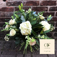 Our 'Cheshire Pearl' is a Luxury Bouquet for lovers of a large domed bouquet full of wonderful white and creamy toned flowers.  We will include Roses, Hydrangeas, Lilies and other beautiful white and cream toned flowers, with complementary seasonal foliage.  This bouquet was a bespoke creation for a special lady - and the team loved it so much we thought we would offer it on the website for others to enjoy, too!  (This product will include gift packaging when delivered, we just wanted to show it in it's 'bare stem' form, here!)