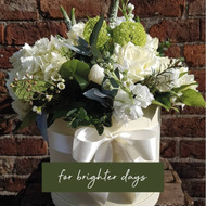 This is a luxury touch, the freshest and most elegant green and white flower selection presented in one of our Chelsea Flowers Hatboxes, with the flourish of a white satin ribbon.   Our florists will choose flowers based on our wholesalers' availability, so occasionally flower content will differ - although the overall style will remain.