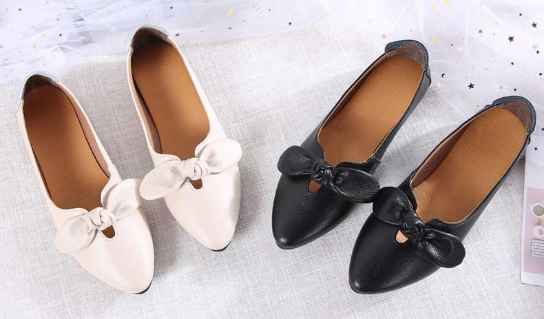 Women's low cut point toe butterfly slip on shoe flat