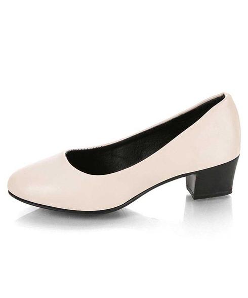 Beige slip on low thick heel dress shoe in plain