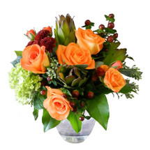 """This is a perfect gift of seasonal flowers.  Five Roses are accented by Hydrangea, Spray Roses, Hypericum, Safari Sunset, Seeded Eucalyptus, and Fall Mums.  12"""" wide by 16"""" tall"""