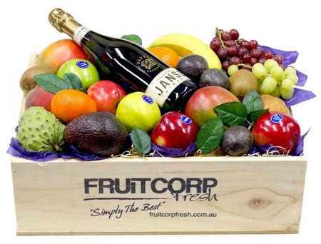 A beautiful hand crafted gift box with fresh fruit and a bottle of Jansz Champagne.