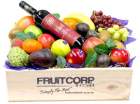 Delicious Fresh Fruit in a hand Crafted wooden basket with a Bottle of Filsell Shiraz Wine.