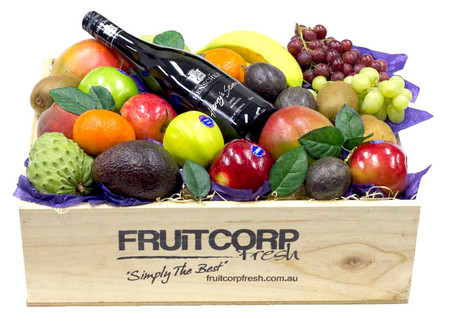 A Hand Crafted Wooden Box with Fresh Fruit and a bottle of Henschke Henry's Seven Shiraz.