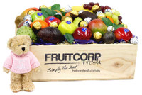"Mixed Seasonal Fruit Beautifully presented in a hand crafted wooden gift box with Baci and Ferrero Rocher Chocolates and a adorable little cuddly teddy bear wearing a pink jumper that has ""It's A Girl"" written on it."
