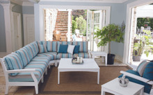 Classic Terrace Sectional shown in White with Gateway Mist Cushions