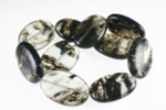 20x30x7mm Reconstituted Black Lolite Oval 10pcs.