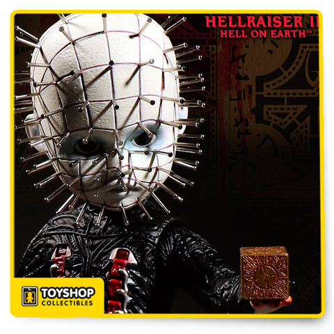 From the velvety darkness of the underworld comes the High Priest of Hell himself: Pinhead. The leader of the Cenobites is the latest addition to world of the Living Dead Dolls. It was nearly three decades ago that the Patron Saint of Piercing first glared at moviegoers from the shadows. Today his followers are legion, and Mezco answers their cries with a Living Dead Doll sure to bring salve to their perpetual torment. From his grid-scarred head to his multitude of piercings, great care has been paid to each exquisite detail. His vestments embody the repulsive glamour of the films. The flayed portions of his flesh bear witness to his suffering. His sacred instruments; hooks, picks, and blades, dangle from his holy robes. To open the doorway to the other realm, he carries a Lament Configuration. The puzzle box seems to beckon. Do you have the will to resist the temptation of its call? Pinhead stands ten inches tall. Packaged in a specially die-cut window box based on the divine mathematics of Lemarchand, you can free him.