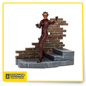 Height: 7 inches tall on base. Articulation: Neck, shoulders, right elbow, forearms, chest, ankles. Total of nine points of articulation. Accessories: Two-part brick wall base with integrated foot pegs, two handguns and removable sunglasses.