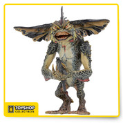 "It's the most evil Gremlin of them all! From Gremlins 2: The New Batch, Mohawk stands over 6"" tall and features incredible movie-accurate detail. He's fully articulated, including a hinged jaw, and includes with a machine gun accessory. Comes in clamshell packaging. The perfect addition to your Gremlins collection!"
