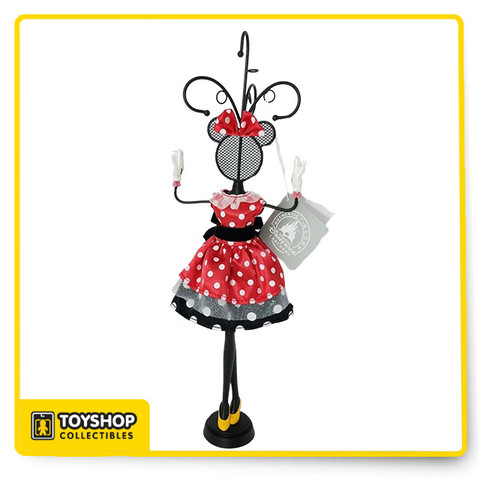 Jewelry always looks good on the forever fashionable Minnie, never more so than with this novel jewelry stand. Styled as a chic Minnie mannequin, complete with her polka dot dress, it has handy hooks for all your valuables.  Metal and resin with fabric dress and bow Red polka dot dress with tulle, and black polka dot underskirt Velvet band at waist with bow at back Metal / resin / polyester Imported